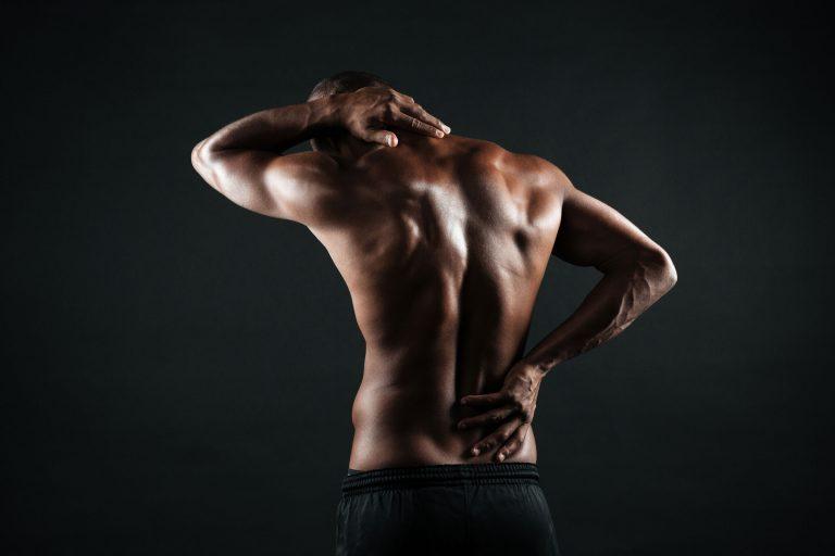 Fitness, Rücken eines muskulösen Mannes, Dysbalancen, Rückenschmerzen